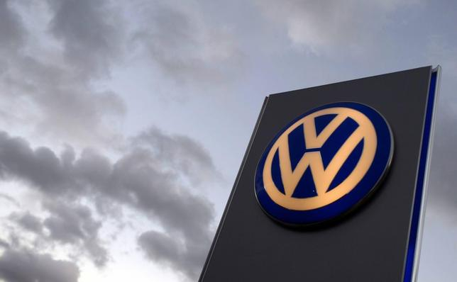 The logo of German carmaker Volkswagen is seen at a VW dealership in Hamburg, in this file picture taken October 28, 2013. REUTERS/Fabian Bimmer
