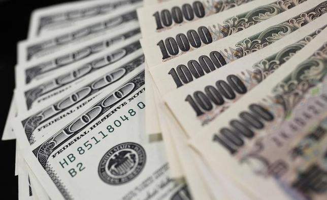 A picture illustration shows U.S. 100 dollar bank notes and Japanese 10,000 yen notes taken in Tokyo August 2, 2011. REUTERS/Yuriko Nakao
