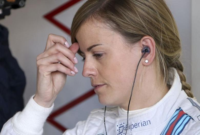 Williams Formula One test driver Susie Wolff of Britain scratches her head before the first practice session for the British Grand Prix at the Silverstone Race circuit, central England, July 4, 2014.   REUTERS/Francois Lenoir