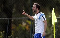 Argentina's national team player Gonzalo Higuain reacts during a training session at Ciudad do Galo grounds in Vespasiano, outside Belo Horizonte, June 18, 2014.  Argentina will face Iran in their 2104 World Cup Group F second match on June 21.  REUTERS/Sergio Perez (BRAZIL  - Tags: SPORT SOCCER WORLD CUP)