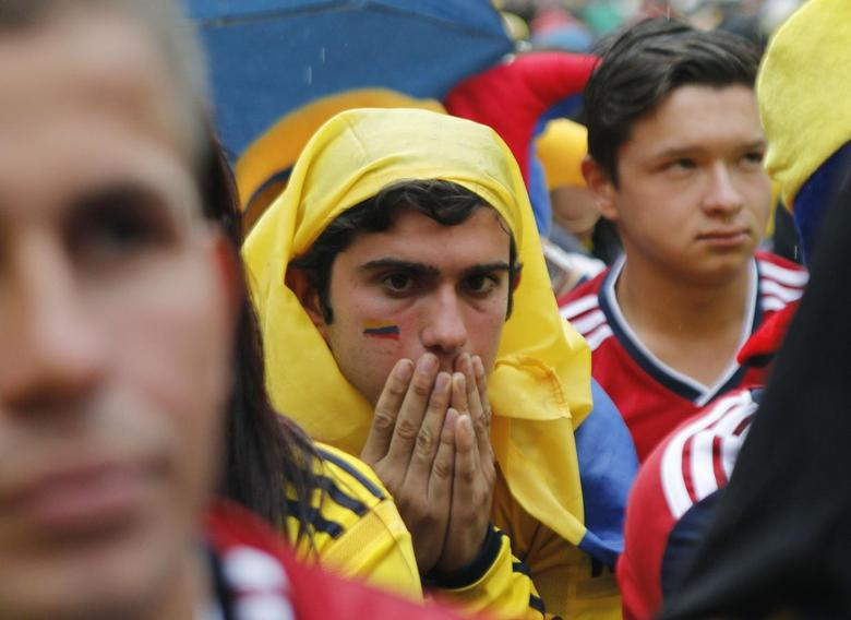 A Colombian fan reacts after Colombia was defeated by Brazil in their World Cup quarter-final match, at a public viewing in Bogota July 4, 2014. REUTERS/Fredy Builes