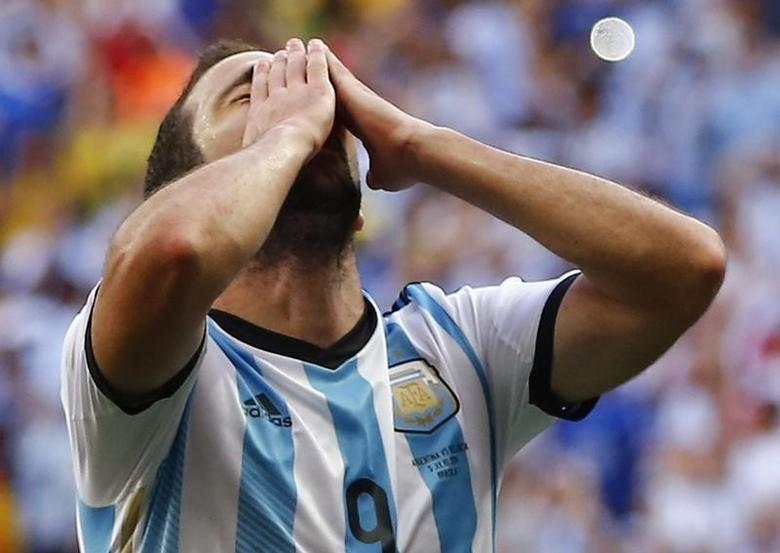 Argentina's Gonzalo Higuain reacts after missing the goal during the 2014 World Cup quarter-finals between Argentina and Belgium at the Brasilia national stadium in Brasilia July 5, 2014.  REUTERS/Dominic Ebenbichler