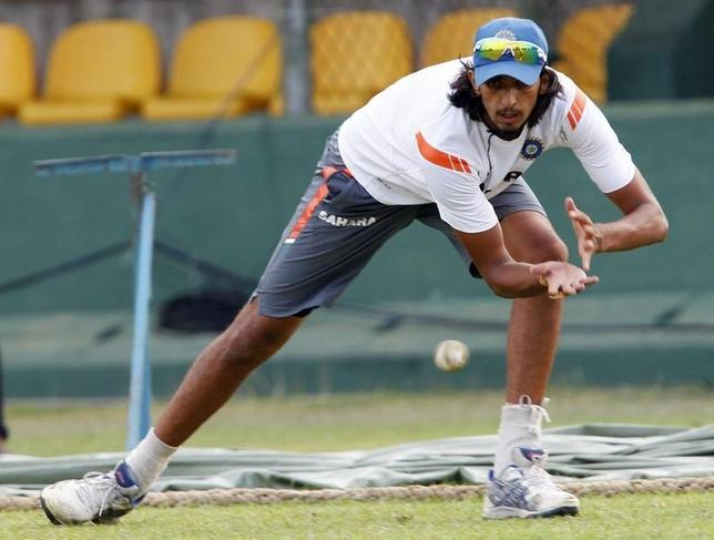 Ishant Sharma catches a ball during a practice session in Dambulla August 12, 2010. REUTERS/Andrew Caballero-Reynolds/Files
