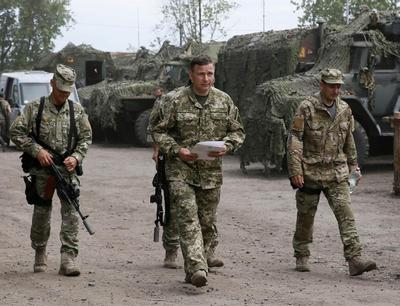Ukraine says forces will press forward after taking...