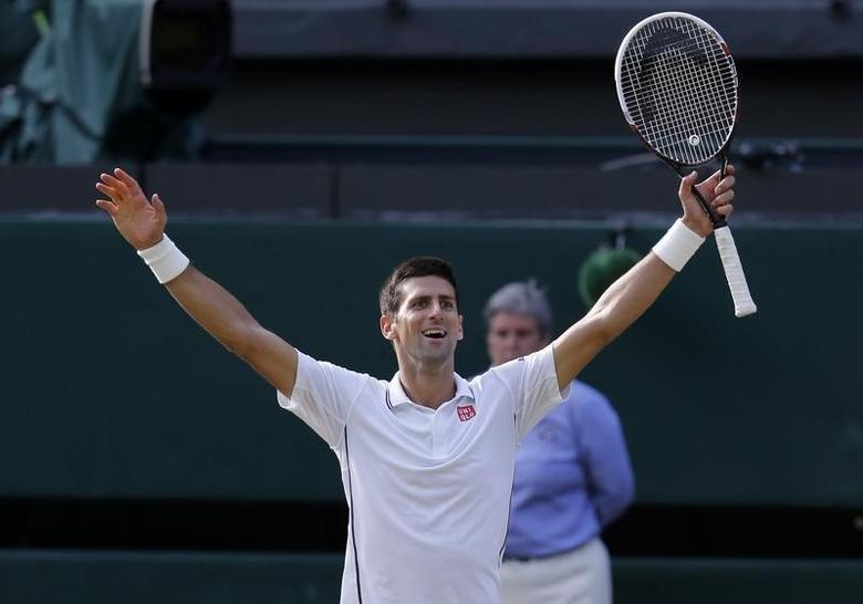 Novak Djokovic of Serbia celebrates defeating Roger Federer of Switzerland in their men's singles final tennis match at the Wimbledon Tennis Championships, in London July 6, 2014.              REUTERS/Suzanne Plunkett (BRITAIN  - Tags: SPORT TENNIS TPX IMAGES OF THE DAY)   - RTR3XD0N