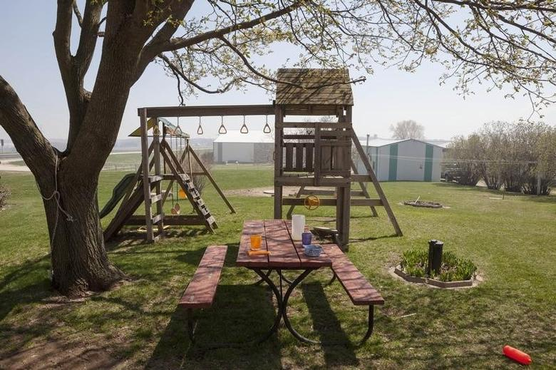 A children's play area sits outside the back door of Melissa and Todd Puchalla's Kiel, Wisconsin, farm house May 21, 2013. REUTERS/Sara Stathas