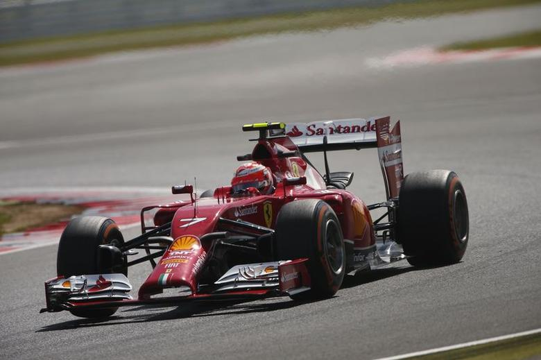 Ferrari Formula One driver Kimi Raikkonen of Finland races during first practice ahead of the British Grand Prix at the Silverstone Race Circuit, central England, July 4, 2014. REUTERS/Phil Noble