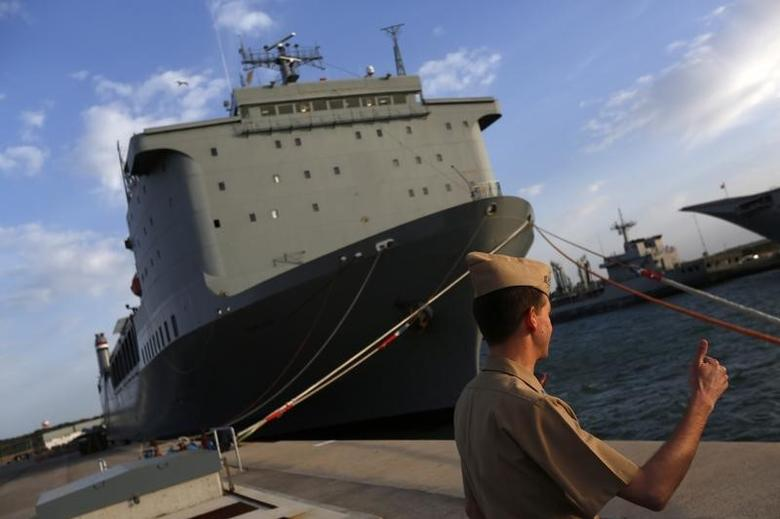 A U.S. navy personnel gestures in front of the U.S. MV Cape Ray ship docked at the naval airbase in Rota, near Cadiz, southern Spain April 10, 2014. REUTERS/Marcelo del Pozo