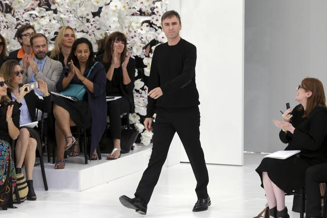Belgian designer Raf Simons appears at the end of his Haute Couture Fall/Winter 2014-2015 fashion collection for French fashion house Christian Dior in Paris July 7, 2014. REUTERS/Philippe Wojazer