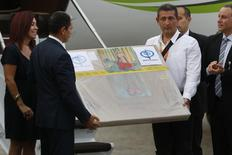 """A box containing a painting of French master Henri Matisse, known as """"Odalisque in Red Pants"""" (Odalisque a la Culotte Rouge), arrives at Maiquetia International Airport in Caracas July 7, 2014. REUTERS/Carlos Garcia Rawlins"""