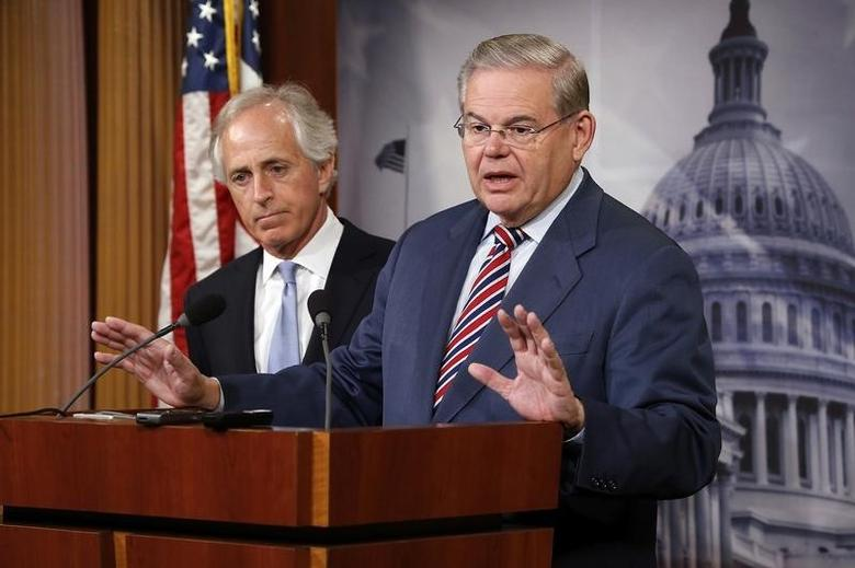 U.S. Senate Foreign Relations Committee Chairman Robert Menendez (D-NJ) (R) and ranking member Senator Bob Corker (R-TN) (L) hold a news conference after a Senate vote on an aid package for Ukraine at the U.S. Capitol in Washington March 27, 2014. REUTERS/Jonathan Ernst