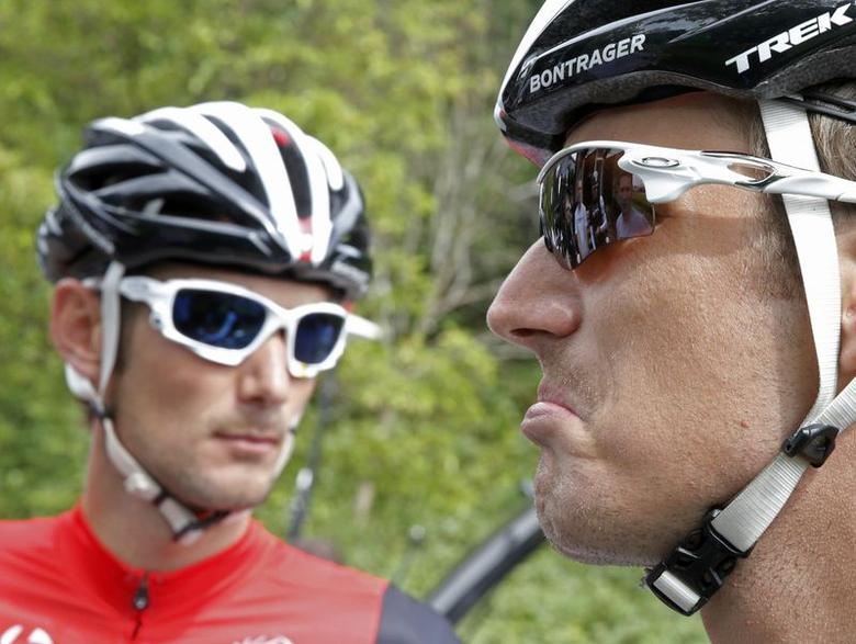 Trek Factory team rider Andy Schleck (R) of Luxembourg reacts next to his brother and team mate Frank Schleck before a training session for the Tour de France cycling race near Leeds, July 4, 2014.  REUTERS/Christian Hartmann