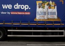Part of a slogan is pictured on the side of a Tesco supermarket delivery truck in New Malden southwest London June 4, 2014.  REUTERS/Luke MacGregor