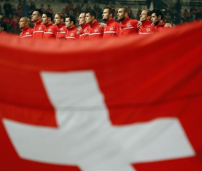 Switzerland's national soccer team sings their national anthem before a friendly soccer match against South Korea at the Seoul World Cup stadium in Seoul November 15, 2013.   REUTERS/Kim Hong-Ji