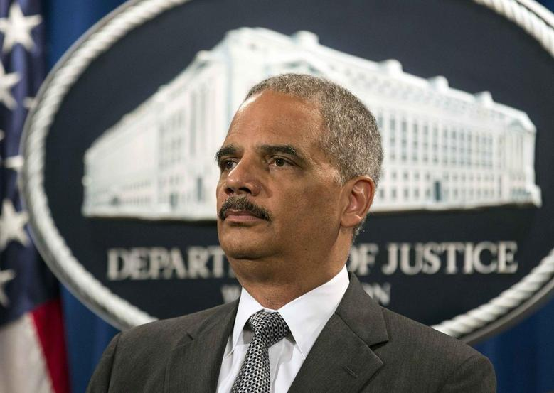 U.S. Attorney General Eric Holder stands during a news conference in Washington June 30, 2014.  REUTERS/Joshua Roberts
