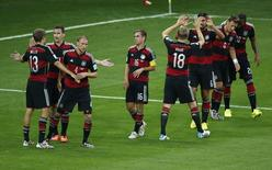 Germany's players celebrate after their teammate Miroslav Klose (2nd L) scored his team's second goal against Brazil during their 2014 World Cup semi-finals at the Mineirao stadium in Belo Horizonte July 8, 2014.   REUTERS/David Gray