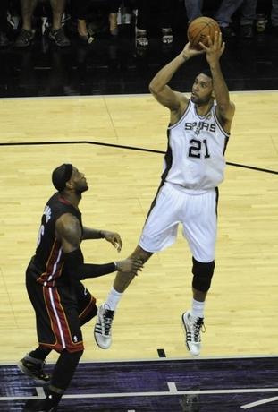 San Antonio Spurs forward Tim Duncan (21) shoots against Miami Heat forward LeBron James (6) in game five of the 2014 NBA Finals at AT&T Center.  Jun 15, 2014; San Antonio, USA ; Brendan Maloney-USA TODAY Sports