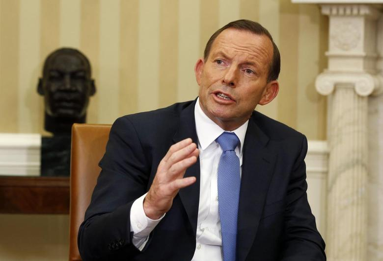 Australian Prime Minister Tony Abbott speaks in the Oval Office of the White House in Washington June 12, 2014.     REUTERS/Larry Downing