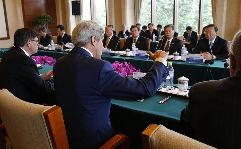 U.S. Secretary of State John Kerry (C) and Treasury Secretary Jack Lew (L) participate in a Joint Session on Climate Change and Clean Energy with China's Minister of Finance Lou Jiwei (3rd R), China's Vice Premier Wang Yang (2nd R) and State Councilor Yang Jiechi (R) at the Diaoyutai State Guesthouse in Beijing, July 9, 2014.    REUTERS/Jim Bourg