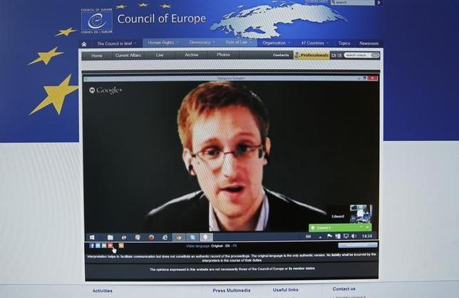 Accused government whistleblower Edward Snowden is seen on the computer screen of a journalist on the internet site of the Council of Europe, as he speaks via video conference with members of the Committee on legal Affairs and Human Rights of the Parliamentary Assembly of the Council of Europe during an hearing on ''mass surveillance'' in Strasbourg, April 8, 2014. REUTERS/Vincent Kessler/Files