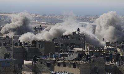Gaza rockets land deep in Israel as it bombards...