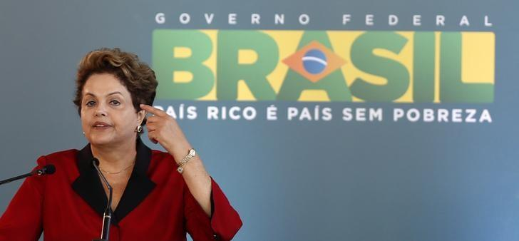 Brazilian President Dilma Rousseff speaks as she attends the inauguration of Terminal 3 at Guarulhos International airport in Sao Paulo May 20, 2014. REUTERS/Paulo Whitaker