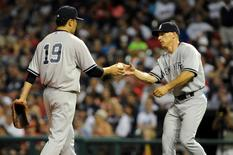 New York Yankees manager Joe Girardi (28) removes starting pitcher Masahiro Tanaka (19) from the game during the seventh inning against the Cleveland Indians at Progressive Field. Jul 8, 2014; Cleveland,USA; Ken Blaze-USA TODAY Sports
