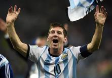 Argentina's Lionel Messi celebrates his team's win over the Netherlands after their 2014 World Cup semi-finals at the Corinthians arena in Sao Paulo July 9, 2014. REUTERS/Dylan Martinez