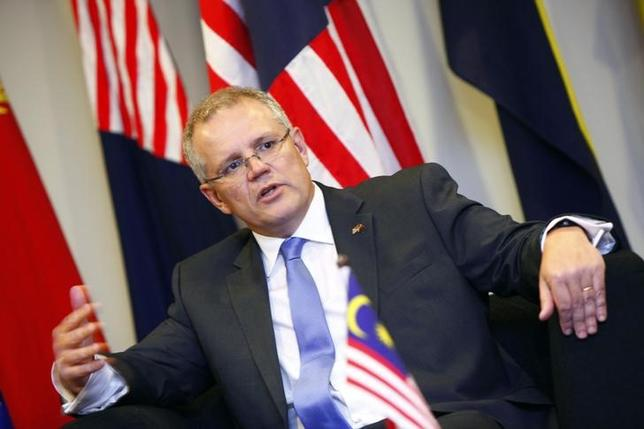 Australia's Minister of Immigration and Border Protection Scott Morrison speaks at a news conference during his working visit to Malaysia, at the Malaysian Maritime Enforcement Agency office in Putrajaya February 5, 2014. REUTERS/Samsul Said