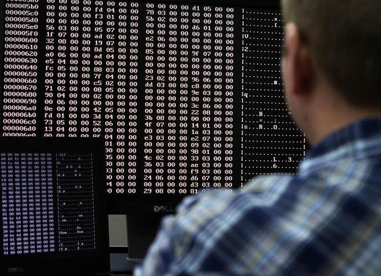An analyst looks at code in the malware lab of a cyber security defense lab in Idaho Falls, Idaho September 29, 2011. REUTERS/Jim Urquhart