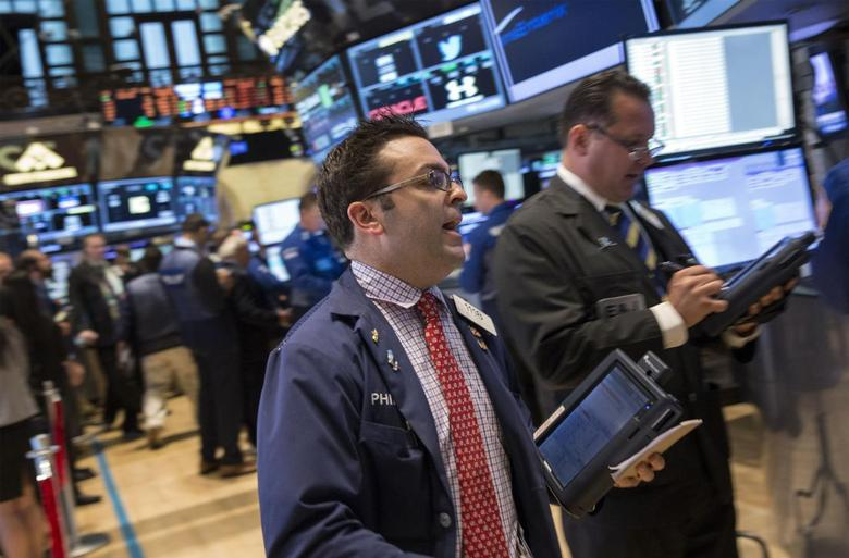 Traders work on the floor of the New York Stock Exchange July 9, 2014. REUTERS/Brendan McDermid