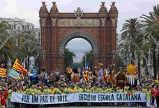 "Demonstrators carry a banner, which reads: ""Decided, Catalan school"", in Barcelona in this June 14, 2014 file photograph. For 30 years, public schools in Spain's Catalonia region have taught most subjects in Catalan, not the national Castilian Spanish language. REUTERS/Gustau Nacarino/Files"