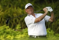 Colin Montgomerie of Scotland tees off on the 12th hole during the first round of the Barclays Singapore Open golf tournament in Sentosa November 8, 2012. REUTERS/Edgar Su