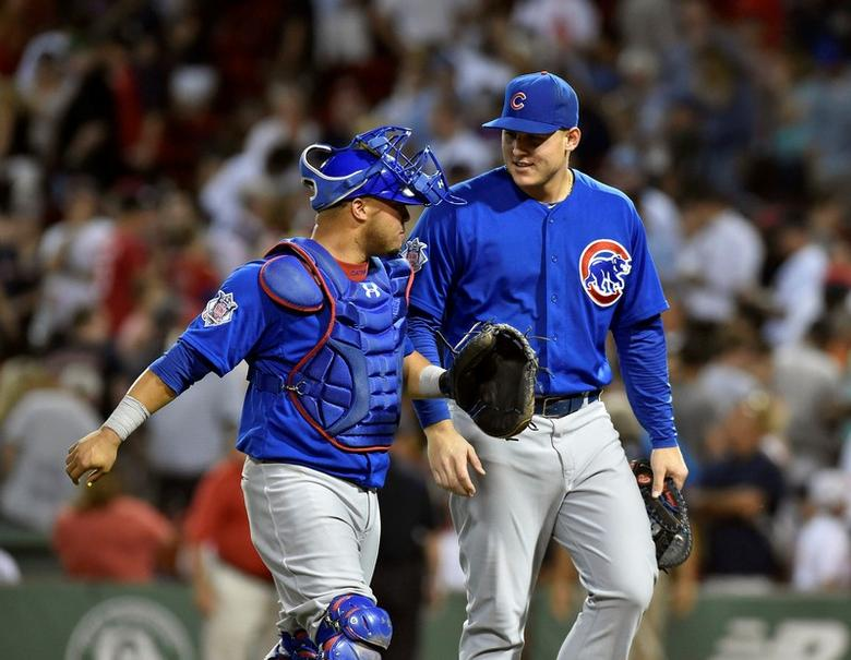 Chicago Cubs catcher Welington Castillo (5) and Chicago Cubs first baseman Anthony Rizzo (44) react after defeating the Boston Red Sox at Fenway Park. Jun 30, 2014; Boston,  USA; Bob DeChiara-USA TODAY Sports