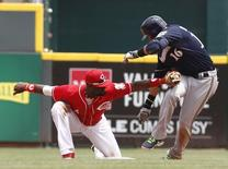 Milwaukee Brewers third baseman Aramis Ramirez (16) is tagged out at second base by Cincinnati Reds second baseman Brandon Phillips (4) during the fifth inning at Great American Ball Park. Jul 6, 2014; Cincinnati, OH, USA;David Kohl-USA TODAY Sports