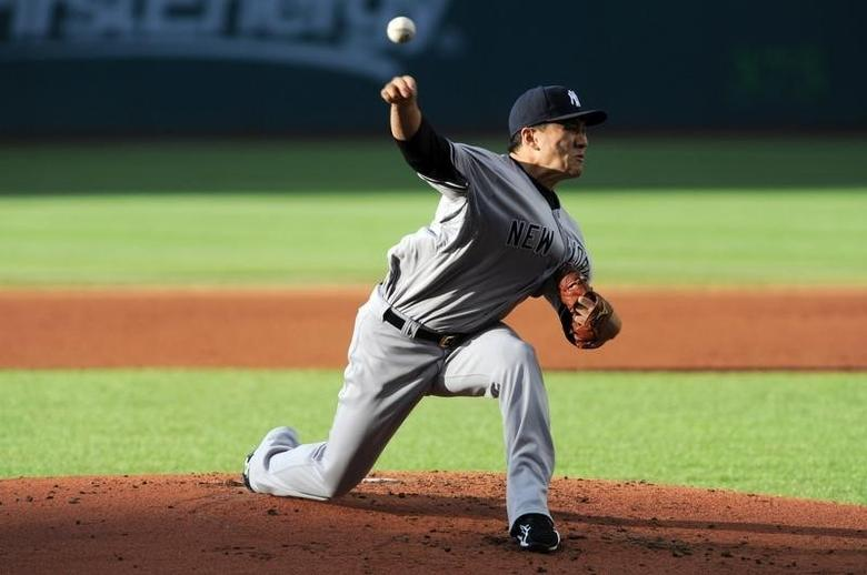 Jul 8, 2014; Cleveland, OH, USA; New York Yankees starting pitcher Masahiro Tanaka (19) pitches during the first inning against the Cleveland Indians at Progressive Field. Mandatory Credit: Ken Blaze-USA TODAY Sports