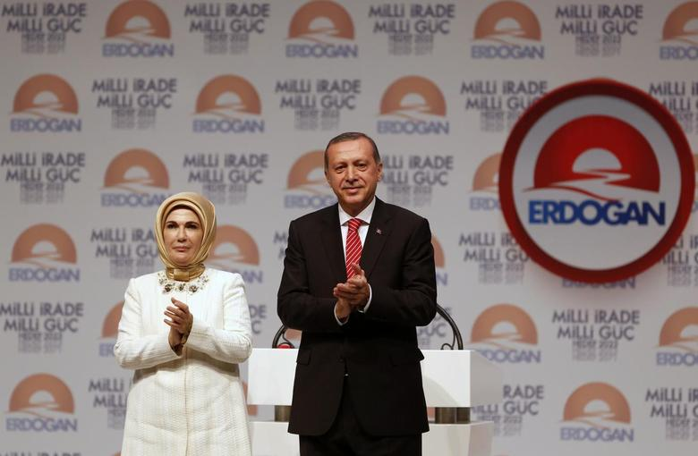 Turkey's Prime Minister and presidential candidate Tayyip Erdogan and his wife Emine Erdogan greet their supporters at the end of a meeting to launch his election campaign in Istanbul July 11, 2014. REUTERS/Murad Sezer