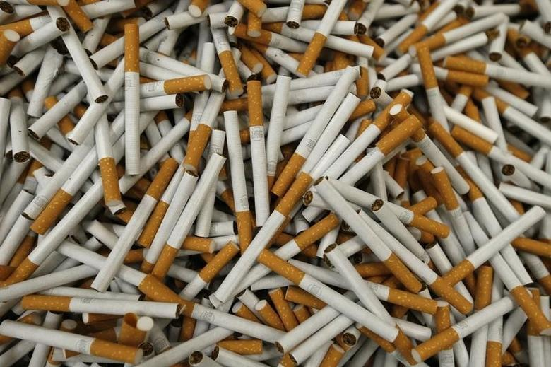Cigarettes are seen during the manufacturing process in Bayreuth, southern Germany, April 30, 2014. REUTERS/Michaela Rehle