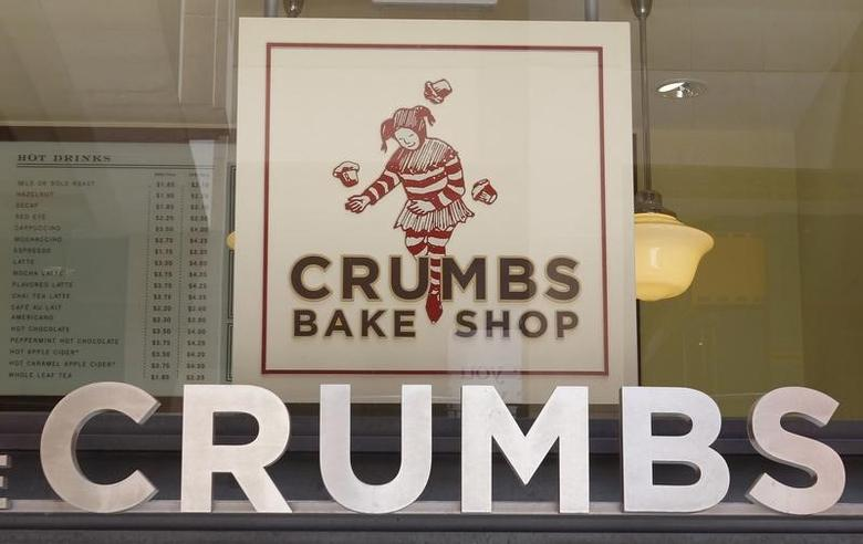 The signage of a Crumbs Bake Shop, which specializes in over 50 varieties of cupcakes, is pictured in Hollywood, California June 29, 2011.REUTERS/Fred Prouser