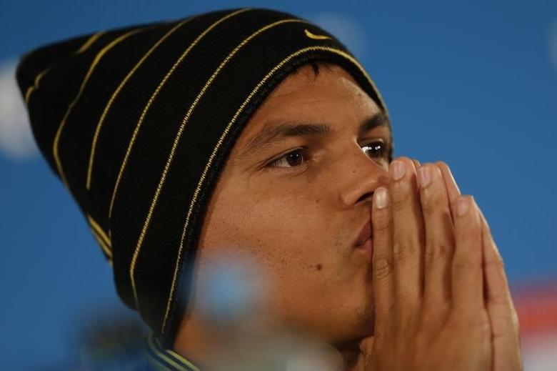 Brazil's national soccer team player Thiago Silva pauses during a news conference at Mane Garrincha National stadium in Brasilia, July 11, 2014.   REUTERS/Ueslei Marcelino