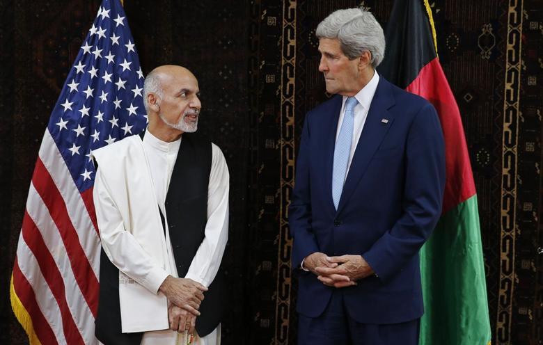 U.S. Secretary of State John Kerry meets Afghanistan's presidential candidate Ashraf Ghani (L) at the U.S. embassy in Kabul July 11, 2014.  REUTERS/Jim Bourg