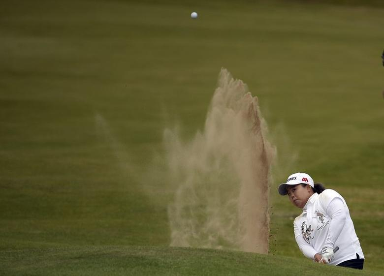 Sun Ju Ahn of South Korea plays a bunker shot at the 18th hole during the women's British Open golf tournament at Royal Birkdale Golf Club in Southport, northern England, July 12, 2014. REUTERS/Nigel Roddis