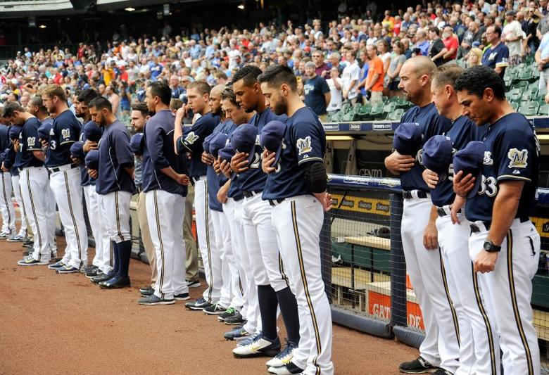 Jul 12, 2014; Milwaukee, WI, USA; Milwaukee Brewer players observed a moment of silence at Miller Park before game against the St. Louis Cardinals after the death of shortstop Jean Segura's 9-month-old son. Segura left the team to travel home to the Dominican Republic.  Mandatory Credit: Benny Sieu-USA TODAY Sports