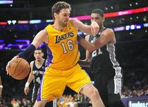 March 19, 2014; Los Angeles, CA, USA; Los Angeles Lakers center Pau Gasol (16) moves to the basket against the San Antonio Spurs during the first half at Staples Center. Mandatory Credit: Gary A. Vasquez-USA TODAY Sports
