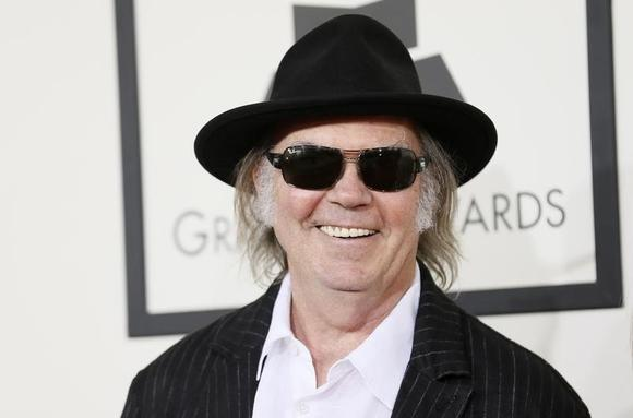 Neil Young arrives at the 56th annual Grammy Awards in Los Angeles, California January 26, 2014. REUTERS/Danny Moloshok/Files