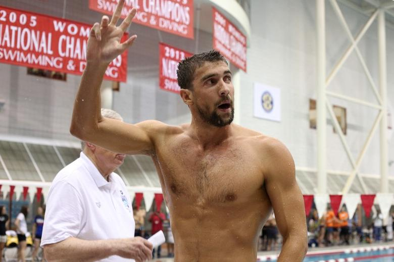 Jul 13, 2014; Athens, GA, USA; Michael Phelps waves to the crowd following the Sunday finals of the Bulldog Grand Slam at Gabrielsen Natatorium. Mandatory Credit: Kevin Liles-USA TODAY Sports