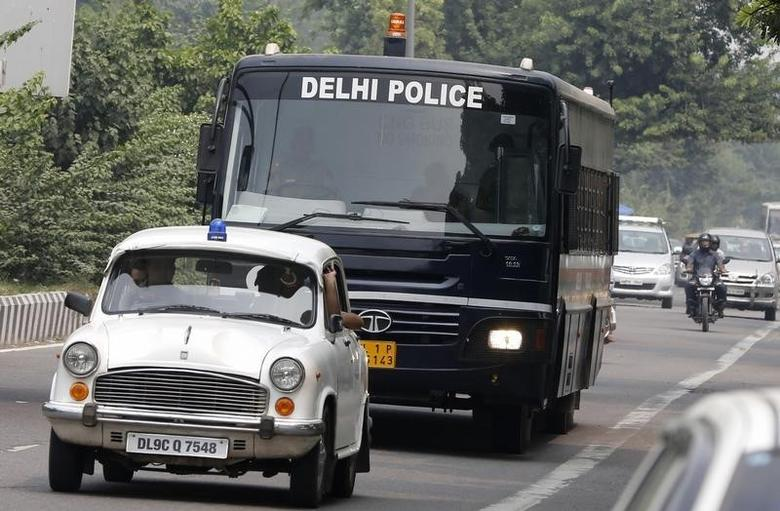 A police bus carrying four men who were found guilty of the fatal gang-rape of a young woman on a bus, arrives at a court in New Delhi September 13, 2013. REUTERS/Adnan Abidi