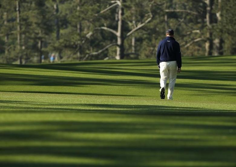 U.S. golfer Tom Watson walks up the second fairway during the first round of the 2014 Masters golf tournament at the Augusta National Golf Club in Augusta, Georgia April 10, 2014. REUTERS/Jim Young