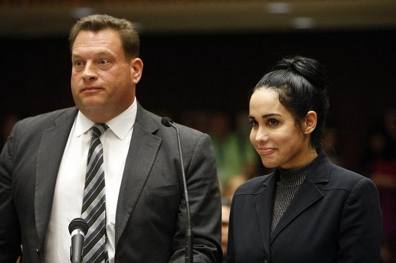 Nadya Suleman appears with her attorney Arthur J. La Cilento (L) for arraignment in Los Angeles, California January 17, 2014.  REUTERS/Al Seib/Pool