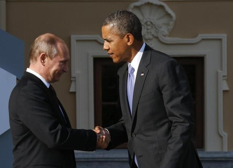 Russia's President Vladimir Putin (L) welcomes U.S. President Barack Obama before the first working session of the G20 Summit in Constantine Palace in Strelna near St. Petersburg, September 5, 2013. REUTERS/Grigory Dukor